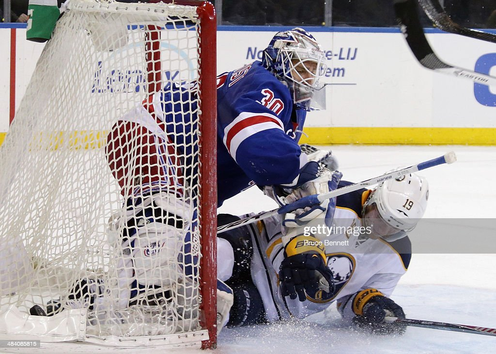 Cody Hodgson #19 of the Buffalo Sabres slides into Henrik Lundqvist #30 of the New York Rangers at Madison Square Garden on April 10, 2014 in New York City. The Rangers defeated the Sabres 2-1.