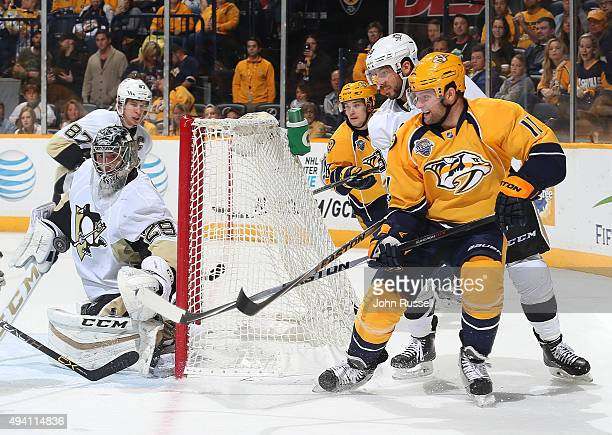 Cody Hodgson of the Nashville Predators centers the puck against MarcAndre Fleury of the Pittsburgh Penguins during an NHL game at Bridgestone Arena...