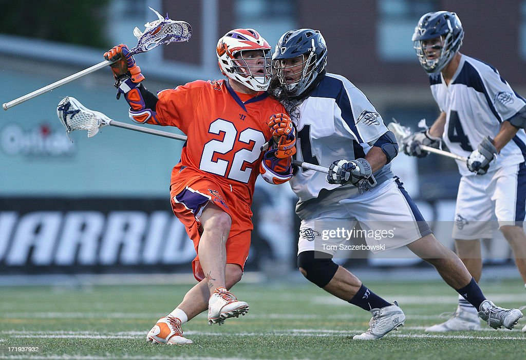 Cody Jamieson #22 of the Hamilton Nationals runs with the ball during Major League Lacrosse game action as Brian Spallina #91 of the Chesapeake Bayhawks defends on June 29, 2013 at Ron Joyce Stadium in Hamilton, Ontario, Canada.