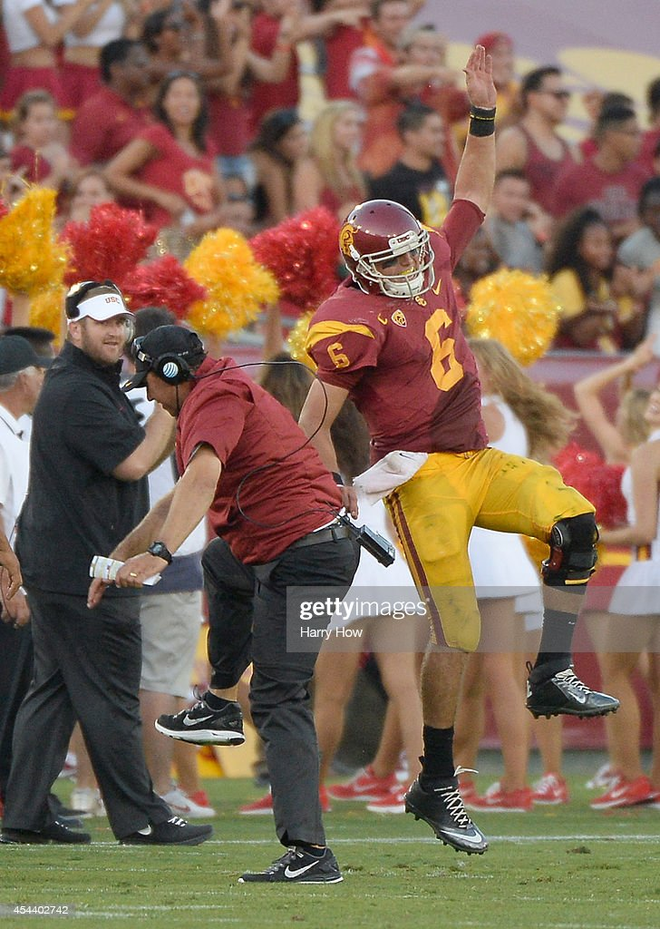 <a gi-track='captionPersonalityLinkClicked' href=/galleries/search?phrase=Cody+Kessler&family=editorial&specificpeople=9870723 ng-click='$event.stopPropagation()'>Cody Kessler</a> #6 of the USC Trojans celebrates his touchdown pass for a 52-13 lead over the Fresno State Bulldogs with Head Coach <a gi-track='captionPersonalityLinkClicked' href=/galleries/search?phrase=Steve+Sarkisian&family=editorial&specificpeople=3908466 ng-click='$event.stopPropagation()'>Steve Sarkisian</a> during the third quarter at Los Angeles Memorial Coliseum on August 30, 2014 in Los Angeles, California.