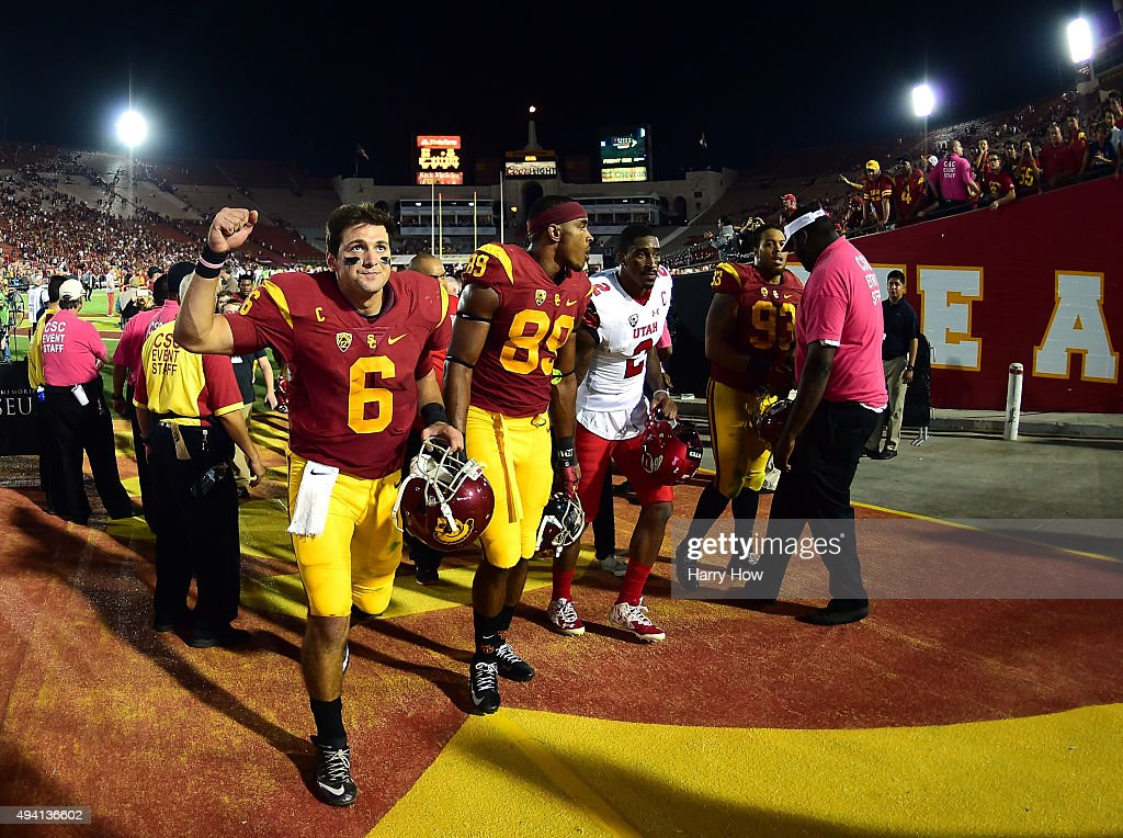 <a gi-track='captionPersonalityLinkClicked' href=/galleries/search?phrase=Cody+Kessler&family=editorial&specificpeople=9870723 ng-click='$event.stopPropagation()'>Cody Kessler</a> #6 of the USC Trojans reacts to fans as he leaves the field after a 42-24 win over the Utah Utes at Los Angeles Memorial Coliseum on October 24, 2015 in Los Angeles, California.