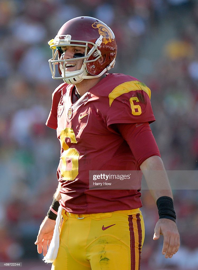 Cody Kessler #6 of the USC Trojans reacts to his touchdown pass to Randall Telfer #82 for a 42-7 lead during the third quarter at Los Angeles Memorial Coliseum on November 29, 2014 in Los Angeles, California.
