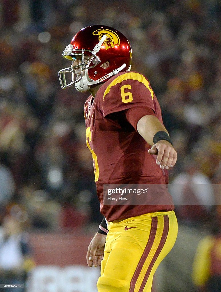 <a gi-track='captionPersonalityLinkClicked' href=/galleries/search?phrase=Cody+Kessler&family=editorial&specificpeople=9870723 ng-click='$event.stopPropagation()'>Cody Kessler</a> #6 of the USC Trojans reacts to his touchdown pass to George Farmer #8 during the fourth quarter against the California Golden Bears at Los Angeles Memorial Coliseum on November 13, 2014 in Los Angeles, California.