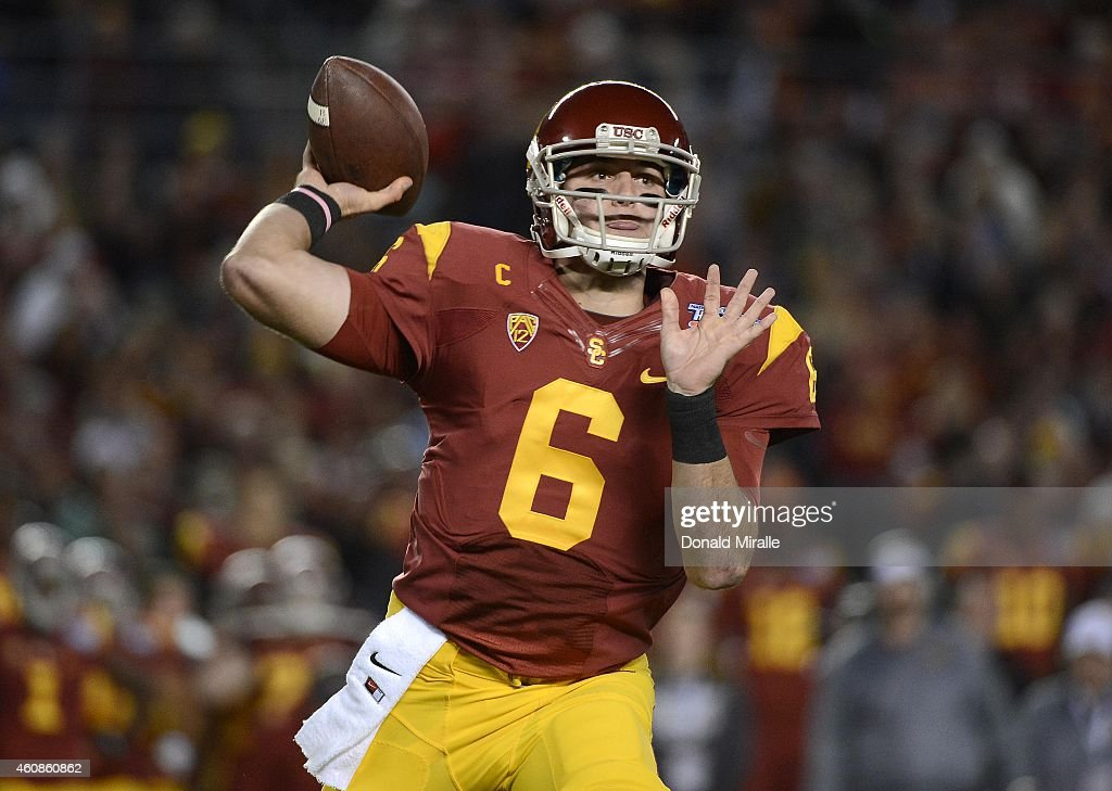 <a gi-track='captionPersonalityLinkClicked' href=/galleries/search?phrase=Cody+Kessler&family=editorial&specificpeople=9870723 ng-click='$event.stopPropagation()'>Cody Kessler</a> #6 of the USC Trojans throws a pass against the Nebraska Cornhuskers during the National University Holiday Bowl on December 27, 2014 at Qualcomm Stadium in San Diego, California.