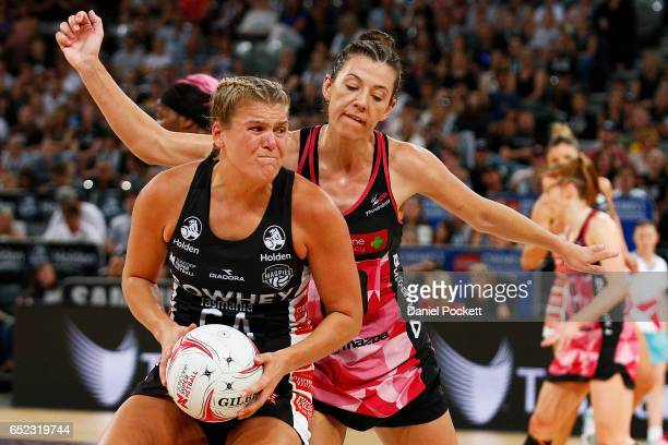 Cody Lange of the Magpies and Fiona Themann of the Thunderbirds contest the ball during the round four Super Netball match between the Magpies and...