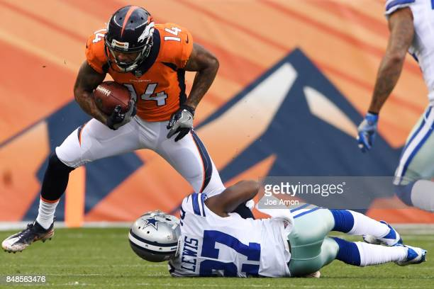 Cody Latimer of the Denver Broncos is tackled by Jourdan Lewis of the Dallas Cowboys after making a catch during the first quarter on Sunday...