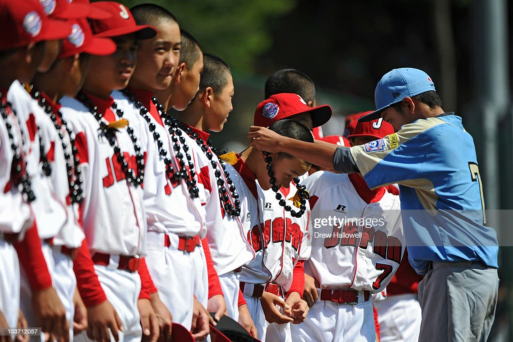 Cody Maltezo #7 of the United States Little League team places a lei on a Japanese player before the game on August 29, 2010 in South Willamsport, Pennsylvania. Japan went on to win the Little League World Series Championship 4-1.