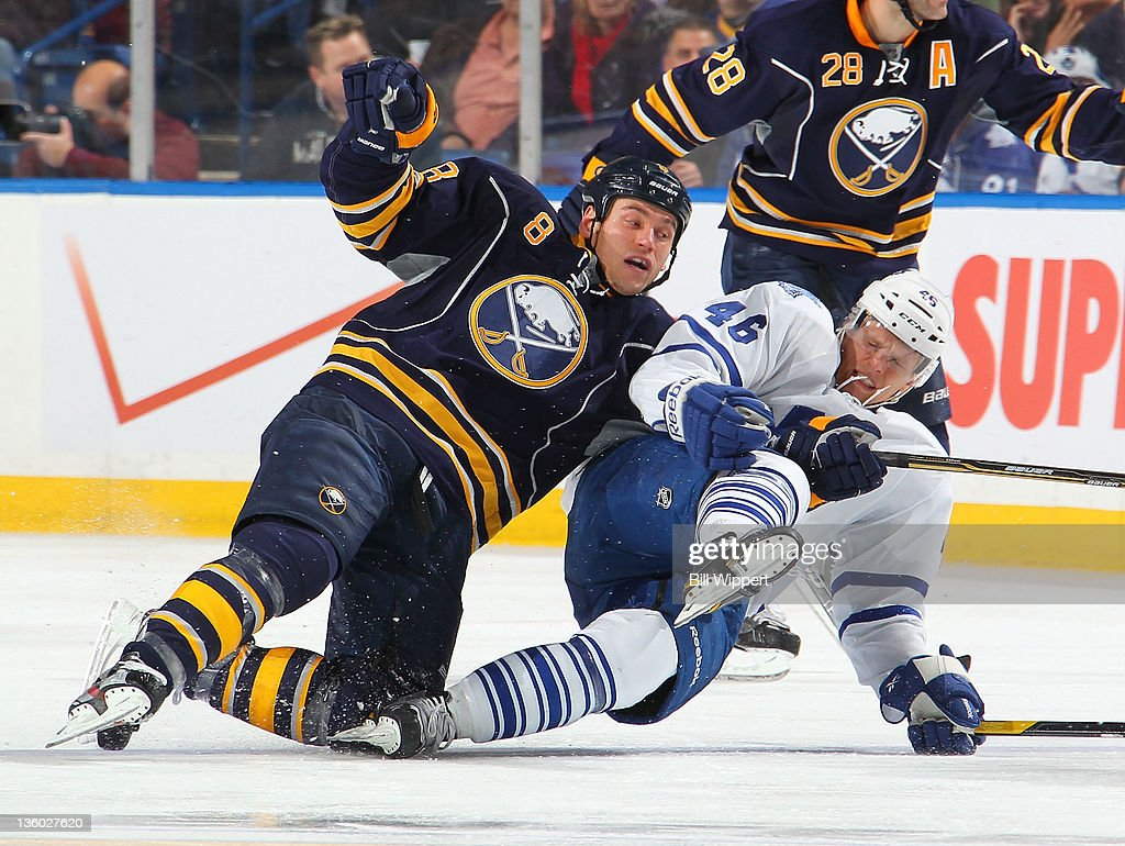 <a gi-track='captionPersonalityLinkClicked' href=/galleries/search?phrase=Cody+McCormick&family=editorial&specificpeople=213546 ng-click='$event.stopPropagation()'>Cody McCormick</a> #8 of the Buffalo Sabres and Joey Crabb#46 of the Toronto Maple Leafs get tangled up while chasing after the puck at First Niagara Center on December 16, 2011 in Buffalo, New York.