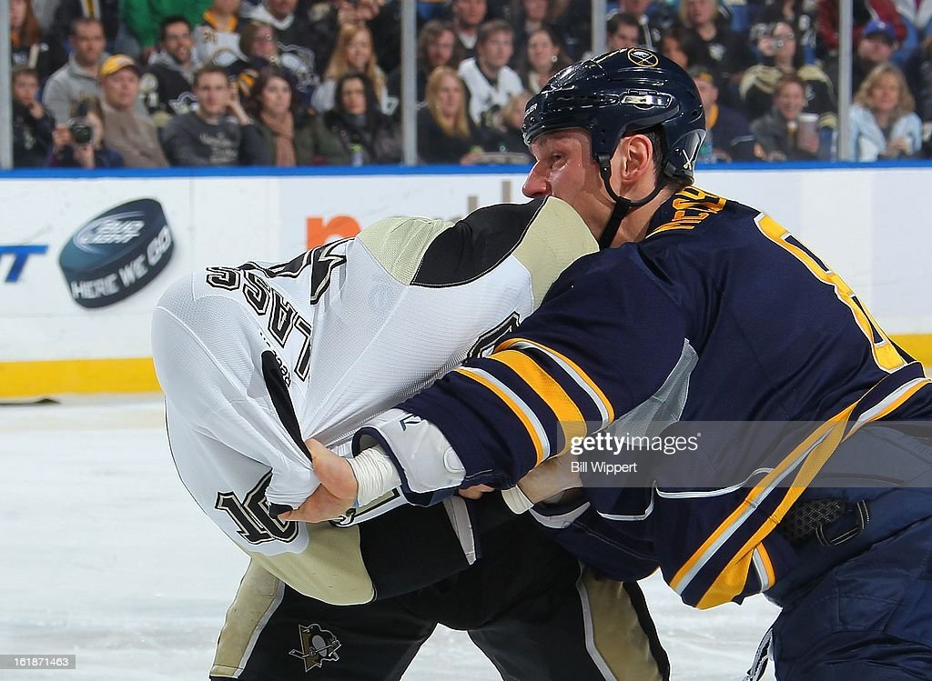 Cody McCormick #8 of the Buffalo Sabres (R) fights Tanner Glass #10 of the Pittsburgh Penguins on February 17, 2013 at the First Niagara Center in Buffalo, New York. Pittsburgh defeated Buffalo, 4-3.
