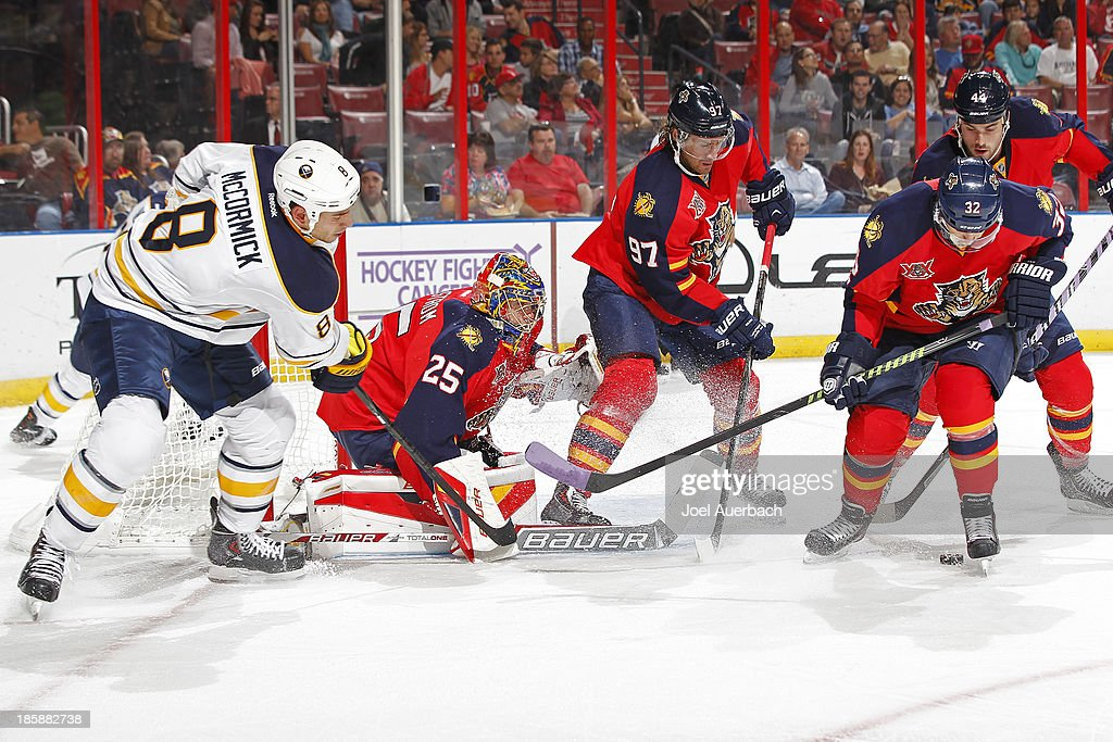 Cody McCormick #8 of the Buffalo Sabres looks for a tip in as Kris Versteeg #32 assists goaltender Jacob Markstrom #25 of the Florida Panthers defend the net at the BB&T Center on October 25, 2013 in Sunrise, Florida.
