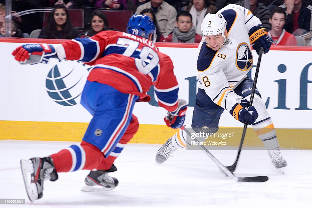Cody McCormick #8 of the Buffalo Sabres shoots the puck in front of Andrei Markov #79 of the Montreal Canadiens during the NHL game at the Bell Centre on February 2, 2013 in Montreal, Quebec, Canada.