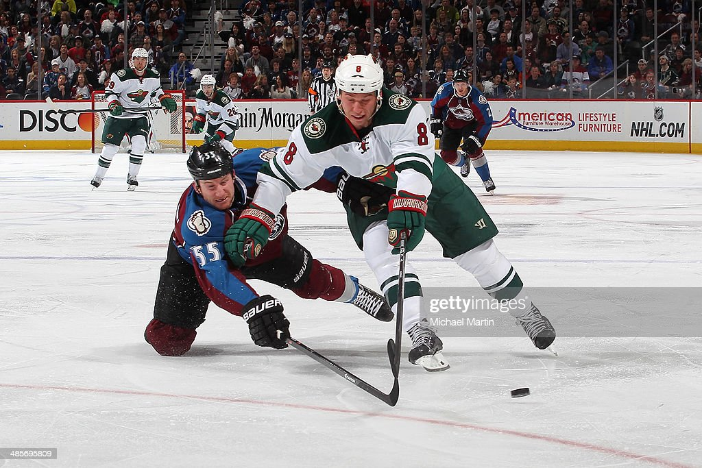 Cody McCormick #8 the Minnesota Wild skates with the puck as Cody McLeod #55 of the Colorado Avalanche challenges in Game Two of the First Round of the 2014 Stanley Cup Playoffs at the Pepsi Center on April 19, 2014 in Denver, Colorado.