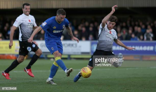 Cody McDonald of AFC Wimbledon scores his sides second goal during the Sky Bet League One match between AFC Wimbledon and Peterborough United at The...