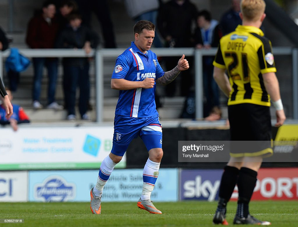 Cody McDonald of Gillingham celebrates scoring a goal during the Sky Bet League One match between Burton Albion and Gillingham at Pirelli Stadium on April 30, 2016 in Burton-upon-Trent, England.