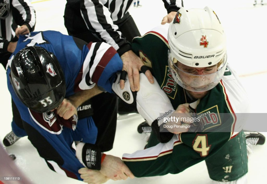 Cody McLeod of the Colorado Avalanche and Clayton Stoner of the Minnesota Wild engage in a fight in the second quarter at the Pepsi Center on...