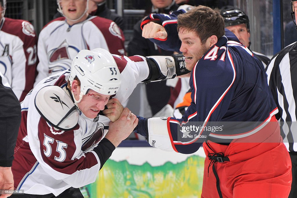 <a gi-track='captionPersonalityLinkClicked' href=/galleries/search?phrase=Cody+McLeod&family=editorial&specificpeople=2242985 ng-click='$event.stopPropagation()'>Cody McLeod</a> #55 of the Colorado Avalanche and <a gi-track='captionPersonalityLinkClicked' href=/galleries/search?phrase=Dalton+Prout&family=editorial&specificpeople=6263673 ng-click='$event.stopPropagation()'>Dalton Prout</a> #47 of the Columbus Blue Jackets fight in the second period on March 3, 2013 at Nationwide Arena in Columbus, Ohio.