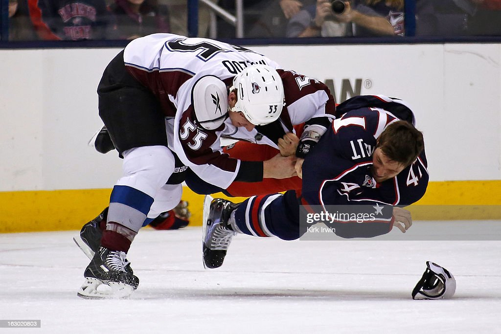 Cody McLeod #55 of the Colorado Avalanche and Dalton Prout #47 of the Columbus Blue Jackets fall to the ice during a fight in the second period on March 3, 2013 at Nationwide Arena in Columbus, Ohio.