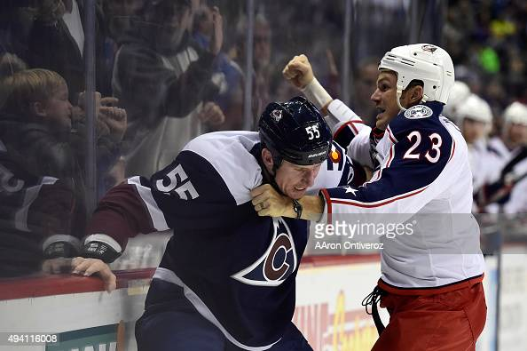 Cody McLeod of the Colorado Avalanche and David Clarkson of the Columbus Blue Jackets exchange blows as fans cheer during the first period The...