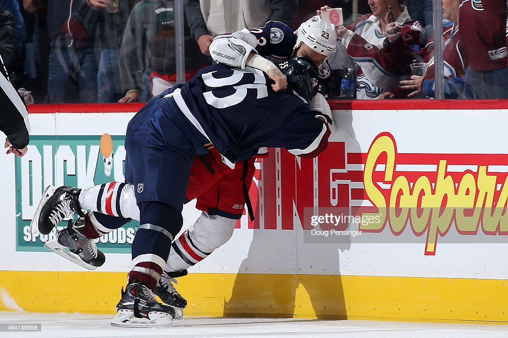 Cody McLeod of the Colorado Avalanche and David Clarkson of the Columbus Blue Jackets wrestle to the ice as they engage in a fight in the first...