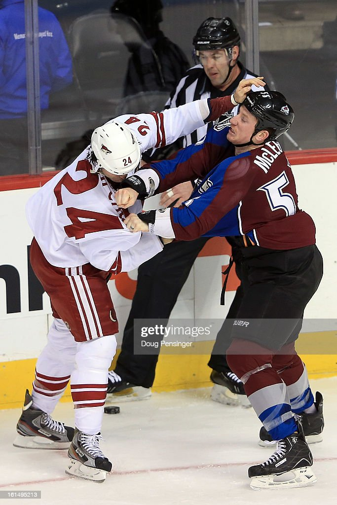 Cody McLeod #55 of the Colorado Avalanche and Kyle Chipchura #24 of the Phoenix Coyotes engage in a fight as linesman Brian Mach #78 oversees the action in the first period at the Pepsi Center on February 11, 2013 in Denver, Colorado.
