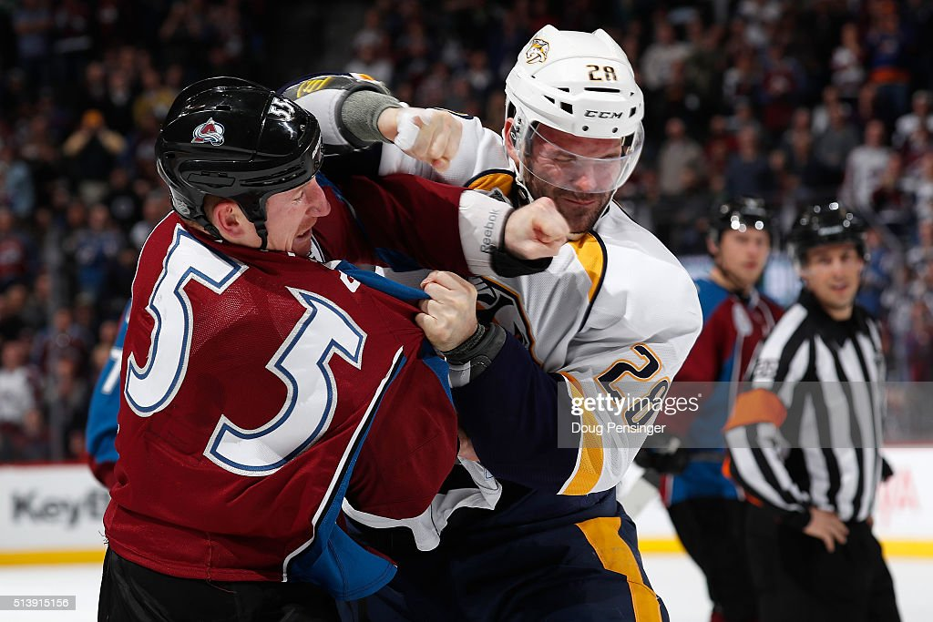 <a gi-track='captionPersonalityLinkClicked' href=/galleries/search?phrase=Cody+McLeod&family=editorial&specificpeople=2242985 ng-click='$event.stopPropagation()'>Cody McLeod</a> #55 of the Colorado Avalanche and <a gi-track='captionPersonalityLinkClicked' href=/galleries/search?phrase=Paul+Gaustad&family=editorial&specificpeople=577980 ng-click='$event.stopPropagation()'>Paul Gaustad</a> #28 of the Nashville Predators throw punches as they engage in a fight in the second period at Pepsi Center on March 5, 2016 in Denver, Colorado.