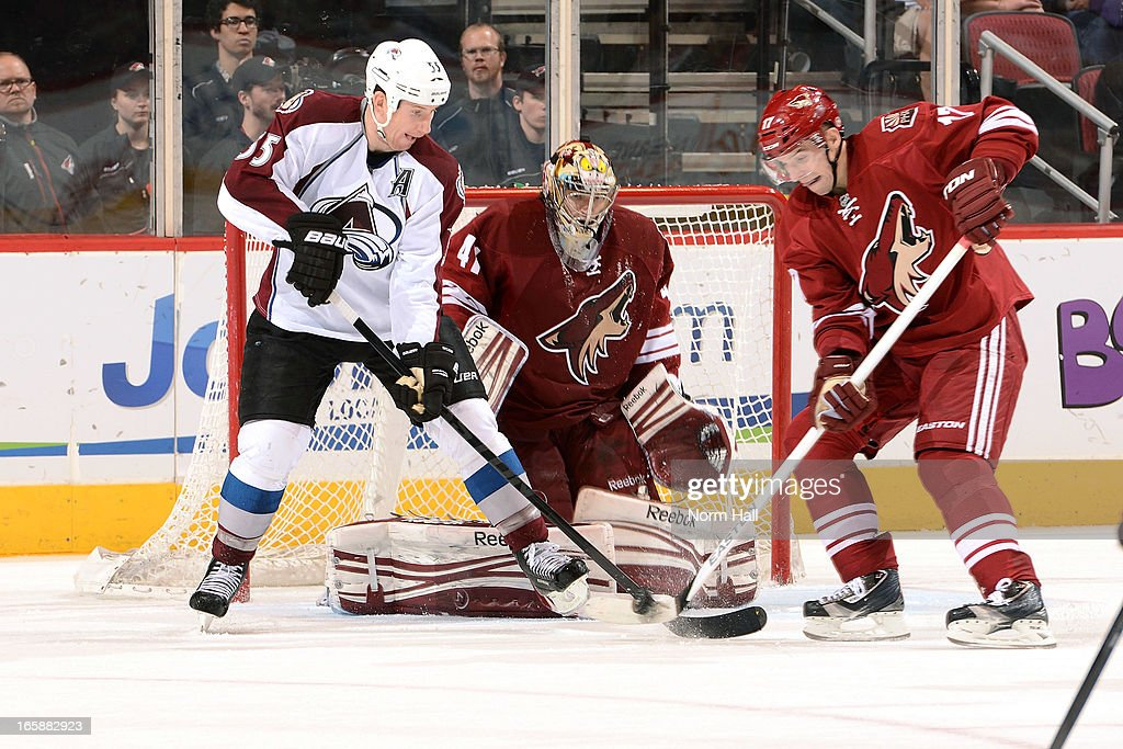 <a gi-track='captionPersonalityLinkClicked' href=/galleries/search?phrase=Cody+McLeod&family=editorial&specificpeople=2242985 ng-click='$event.stopPropagation()'>Cody McLeod</a> #55 of the Colorado Avalanche and <a gi-track='captionPersonalityLinkClicked' href=/galleries/search?phrase=Radim+Vrbata&family=editorial&specificpeople=204716 ng-click='$event.stopPropagation()'>Radim Vrbata</a> #17 of the Phoenix Coyotes battle for the puck in front of goaltender Mike Smith #41 of the Phoenix Coyotes during the third period at Jobing.com Arena on April 6, 2013 in Glendale, Arizona.