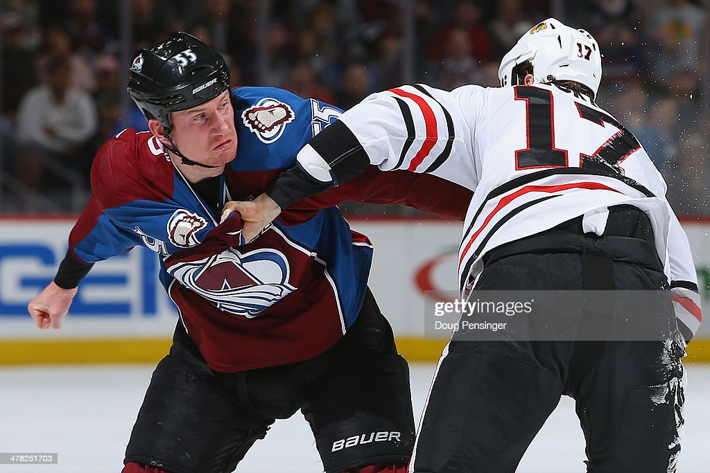Cody McLeod #55 of the Colorado Avalanche and Sheldon Brookbank #17 of the Chicago Blackhawks engage in a fight and draw penalties in the first period at Pepsi Center on March 12, 2014 in Denver, Colorado.