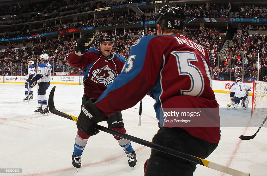 Cody McLeod of the Colorado Avalanche celebrates his first period goal with teammate Kevin Porter of the Colorado Avalanche as the Avalanche took a...