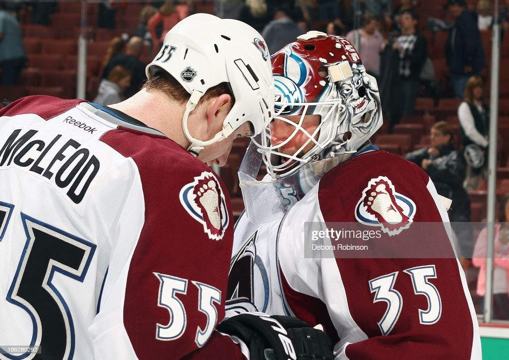 Cody McLeod #55 of the Colorado Avalanche celebrates the win with goalie Jean-Sebastien Giguere #35 against the Anaheim Ducks April 10, 2013 at Honda Center in Anaheim, California.