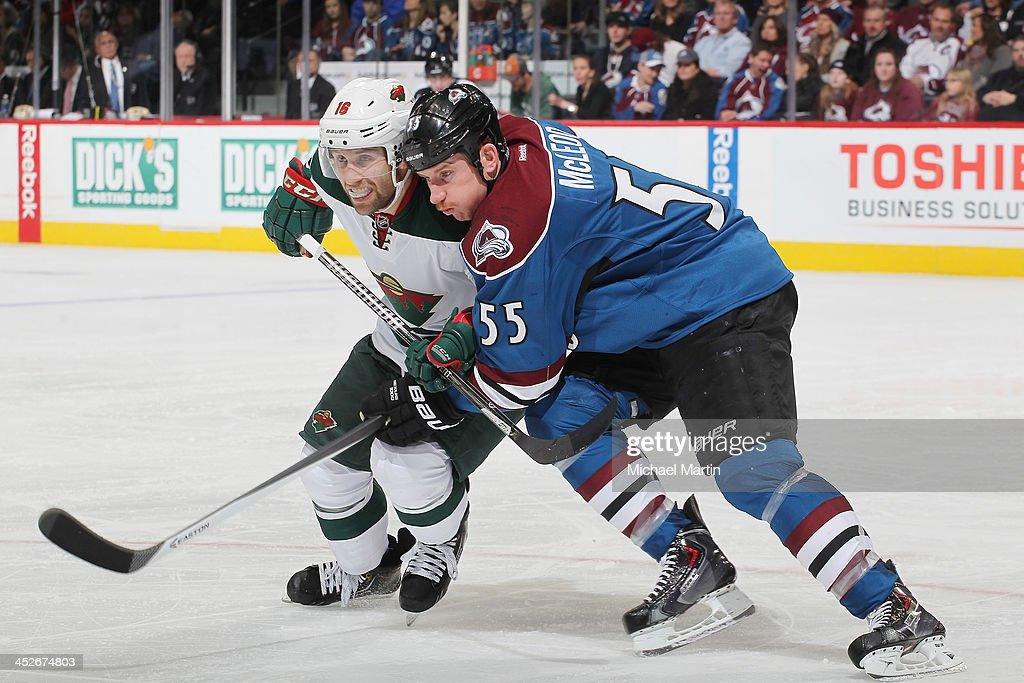 Cody McLeod of the Colorado Avalanche challenges Jason Zucker of the Minnesota Wild at the Pepsi Center on November 30 2013 in Denver Colorado