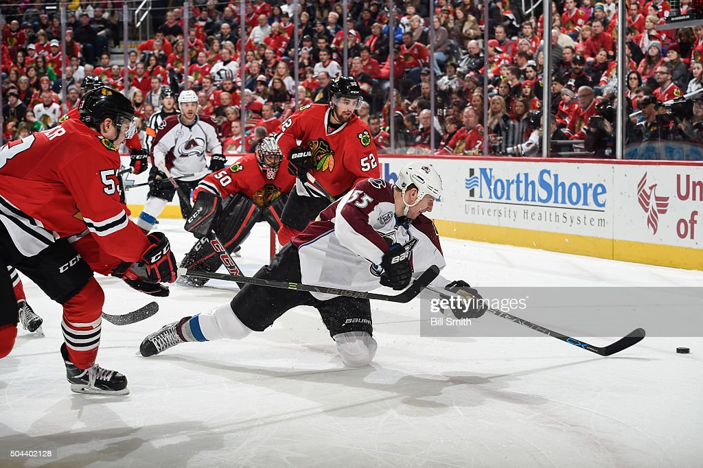 <a gi-track='captionPersonalityLinkClicked' href=/galleries/search?phrase=Cody+McLeod&family=editorial&specificpeople=2242985 ng-click='$event.stopPropagation()'>Cody McLeod</a> #55 of the Colorado Avalanche dives toward the puck against <a gi-track='captionPersonalityLinkClicked' href=/galleries/search?phrase=Brandon+Mashinter&family=editorial&specificpeople=4837957 ng-click='$event.stopPropagation()'>Brandon Mashinter</a> #53 and Erik Gustafsson #52 of the Chicago Blackhawks in the second period of the NHL game at the United Center on January 10, 2016 in Chicago, Illinois.
