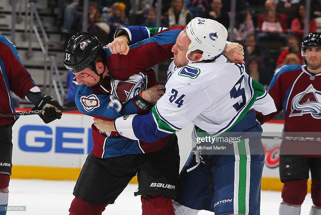 Cody McLeod of the Colorado Avalanche fights against Byron Bitz of the Vancouver Canucks at the Pepsi Center on February 04 2012 in Denver Colorado