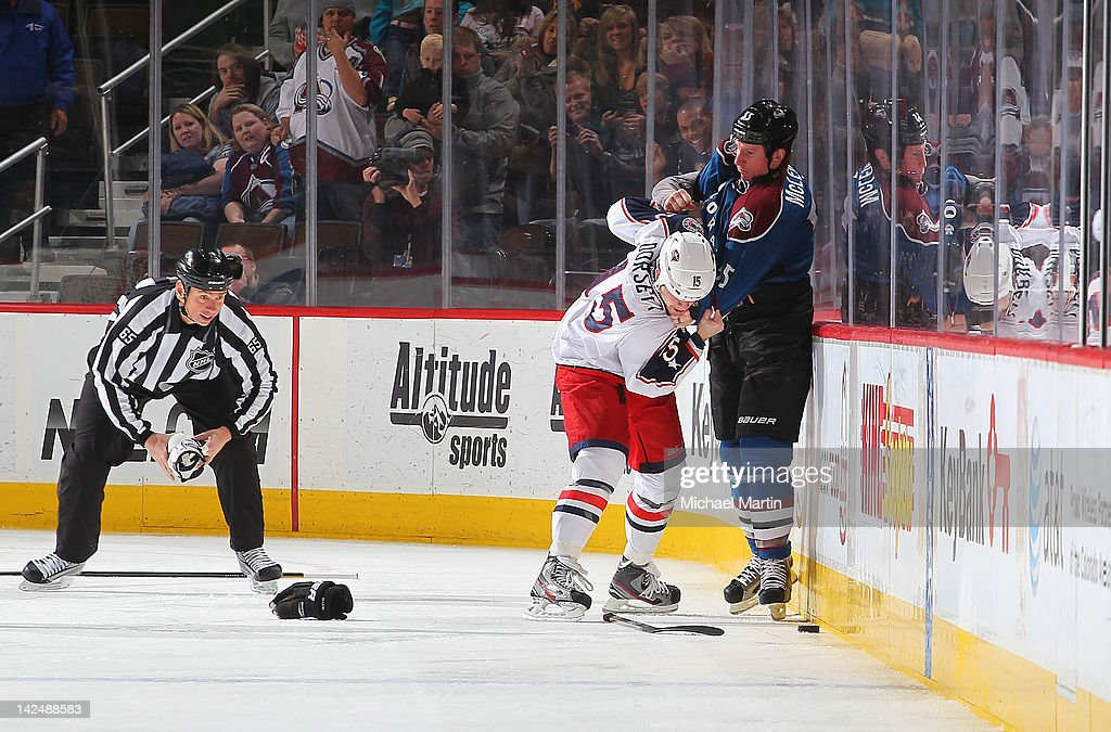 <a gi-track='captionPersonalityLinkClicked' href=/galleries/search?phrase=Cody+McLeod&family=editorial&specificpeople=2242985 ng-click='$event.stopPropagation()'>Cody McLeod</a> #55 of the Colorado Avalanche fights with <a gi-track='captionPersonalityLinkClicked' href=/galleries/search?phrase=Derek+Dorsett&family=editorial&specificpeople=4306277 ng-click='$event.stopPropagation()'>Derek Dorsett</a> #15 of the Columbus Blue Jackets at the Pepsi Center on April 5, 2012 in Denver, Colorado.
