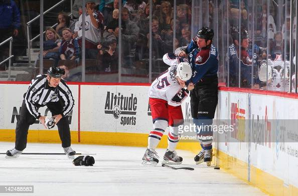 Cody McLeod of the Colorado Avalanche fights with Derek Dorsett of the Columbus Blue Jackets at the Pepsi Center on April 5 2012 in Denver Colorado