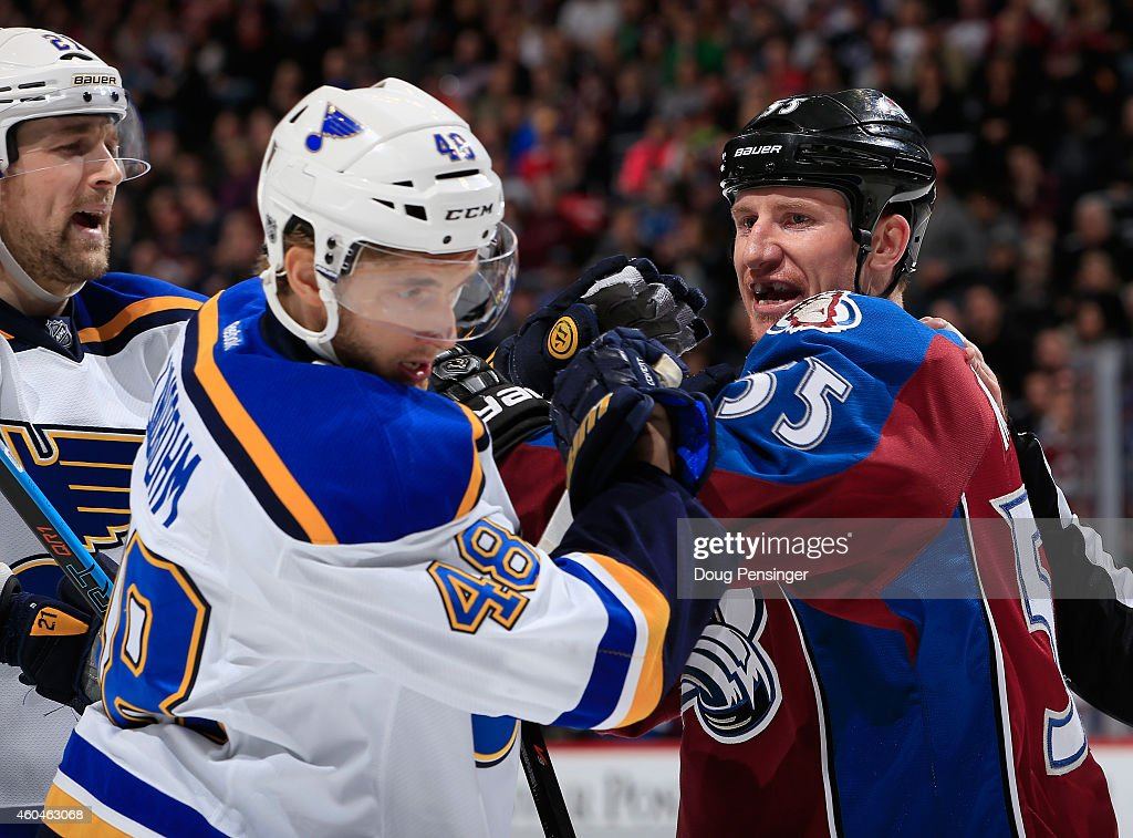 Cody McLeod of the Colorado Avalanche has an exchange with Petteri Lindbohm of the St Louis Blues at Pepsi Center on December 13 2014 in Denver...