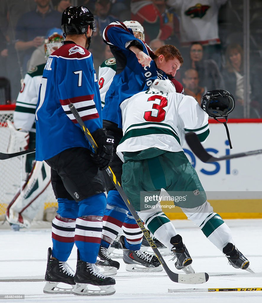 <a gi-track='captionPersonalityLinkClicked' href=/galleries/search?phrase=Cody+McLeod&family=editorial&specificpeople=2242985 ng-click='$event.stopPropagation()'>Cody McLeod</a> #55 of the Colorado Avalanche instigates a fight with <a gi-track='captionPersonalityLinkClicked' href=/galleries/search?phrase=Charlie+Coyle&family=editorial&specificpeople=7029381 ng-click='$event.stopPropagation()'>Charlie Coyle</a> #3 of the Minnesota Wild earning McLeod a two minute penalty for unsportsmanlike conduct, a five minute fighting penalty and a 10 minute misconduct penalty with four seconds remaining in the third period at Pepsi Center on February 28, 2015 in Denver, Colorado. The Wild defeated the Avalanche 3-1.