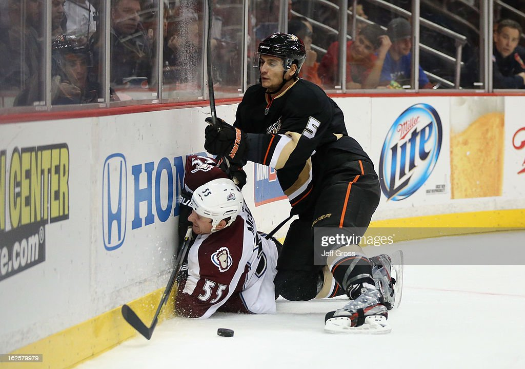 Cody McLeod #55 of the Colorado Avalanche is checked into the boards by Luca Sbisa #5 of the Anaheim Ducks in the second period at Honda Center on February 24, 2013 in Anaheim, California.