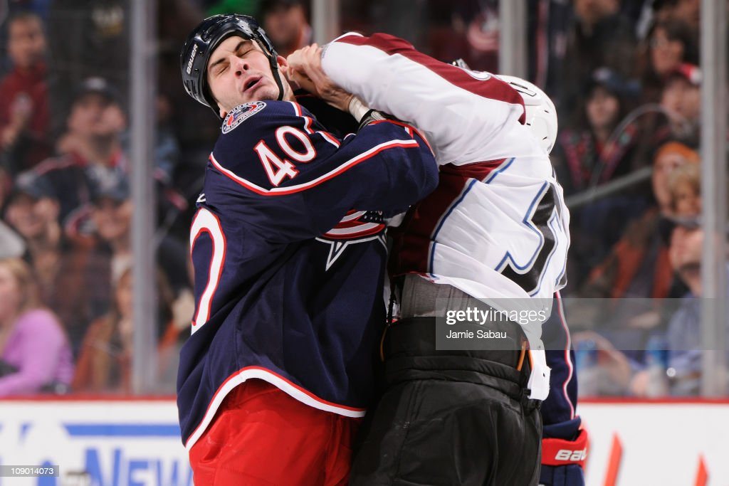 Cody McLeod of the Colorado Avalanche lands a punch on Jared Boll of the Columbus Blue Jackets during a fight in the first period on February 11 2011...
