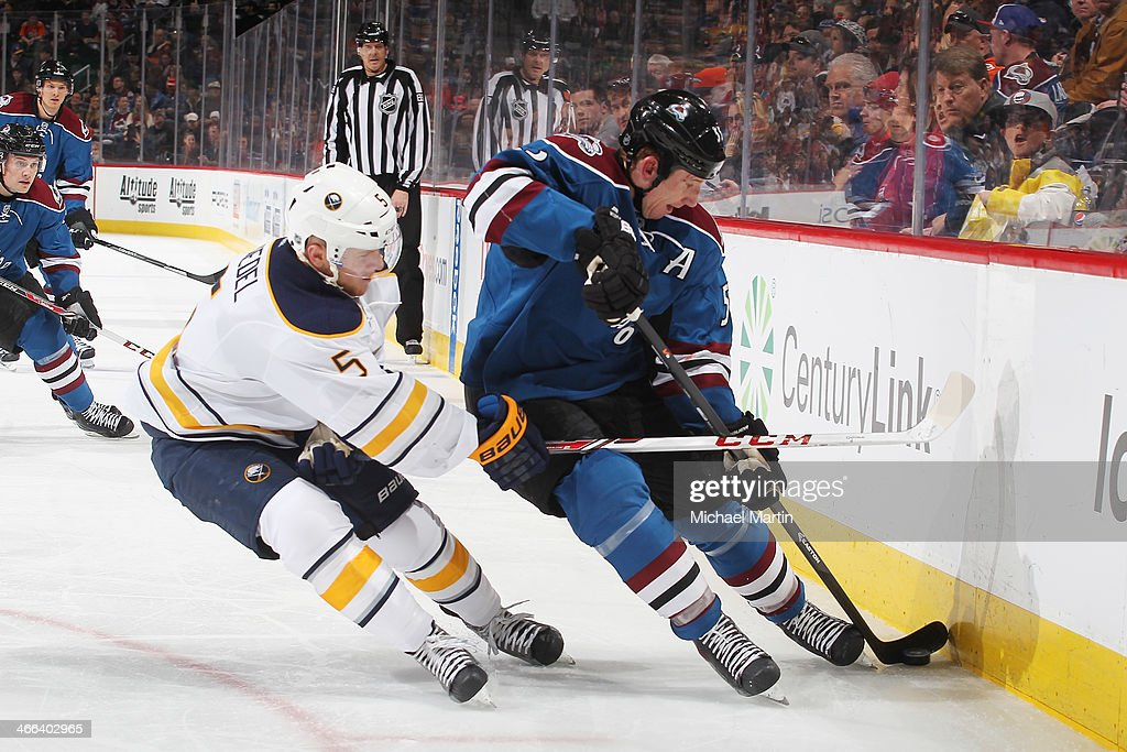 <a gi-track='captionPersonalityLinkClicked' href=/galleries/search?phrase=Cody+McLeod&family=editorial&specificpeople=2242985 ng-click='$event.stopPropagation()'>Cody McLeod</a> #55 of the Colorado Avalanche plays the puck against the boards as he is pursued by Chad Ruhwedel #5 of the Buffalo Sabres at the Pepsi Center on February 1, 2014 in Denver, Colorado. The Avalanche defeated the Sabres 7-1.