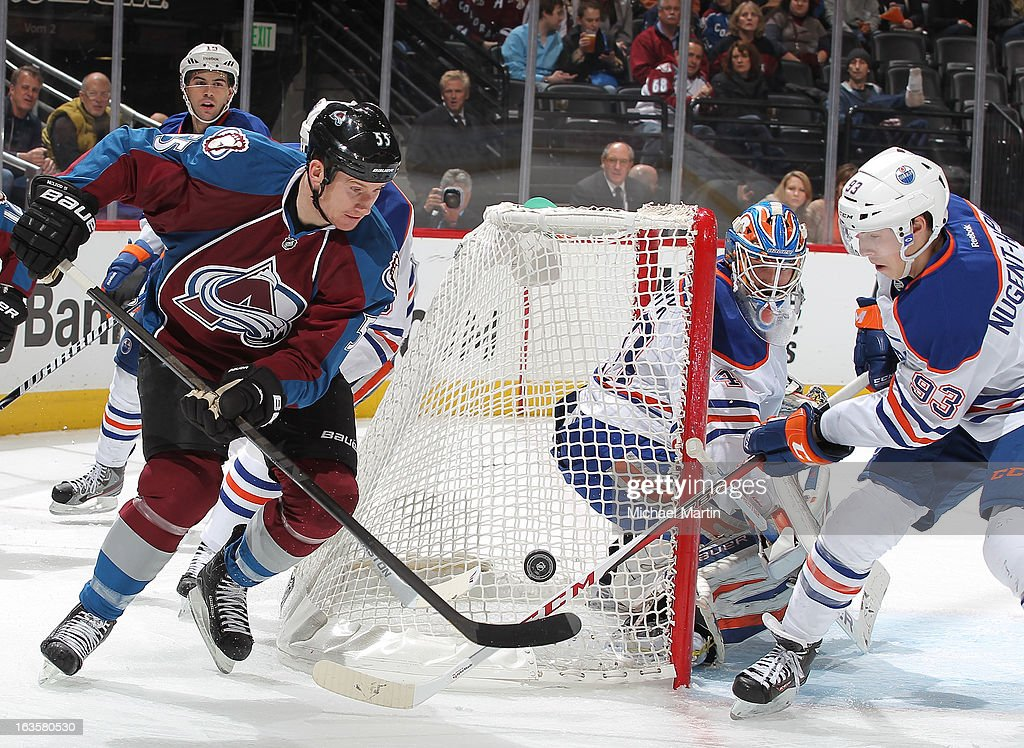 <a gi-track='captionPersonalityLinkClicked' href=/galleries/search?phrase=Cody+McLeod&family=editorial&specificpeople=2242985 ng-click='$event.stopPropagation()'>Cody McLeod</a> #55 of the Colorado Avalanche shoots against <a gi-track='captionPersonalityLinkClicked' href=/galleries/search?phrase=Ryan+Nugent-Hopkins&family=editorial&specificpeople=7144190 ng-click='$event.stopPropagation()'>Ryan Nugent-Hopkins</a> #93 of the Edmonton Oilers at the Pepsi Center on March 12, 2013 in Denver, Colorado.