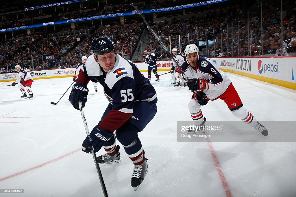Cody McLeod of the Colorado Avalanche skates against Gregory Campbell of the Columbus Blue Jackets at Pepsi Center on October 24 2015 in Denver...