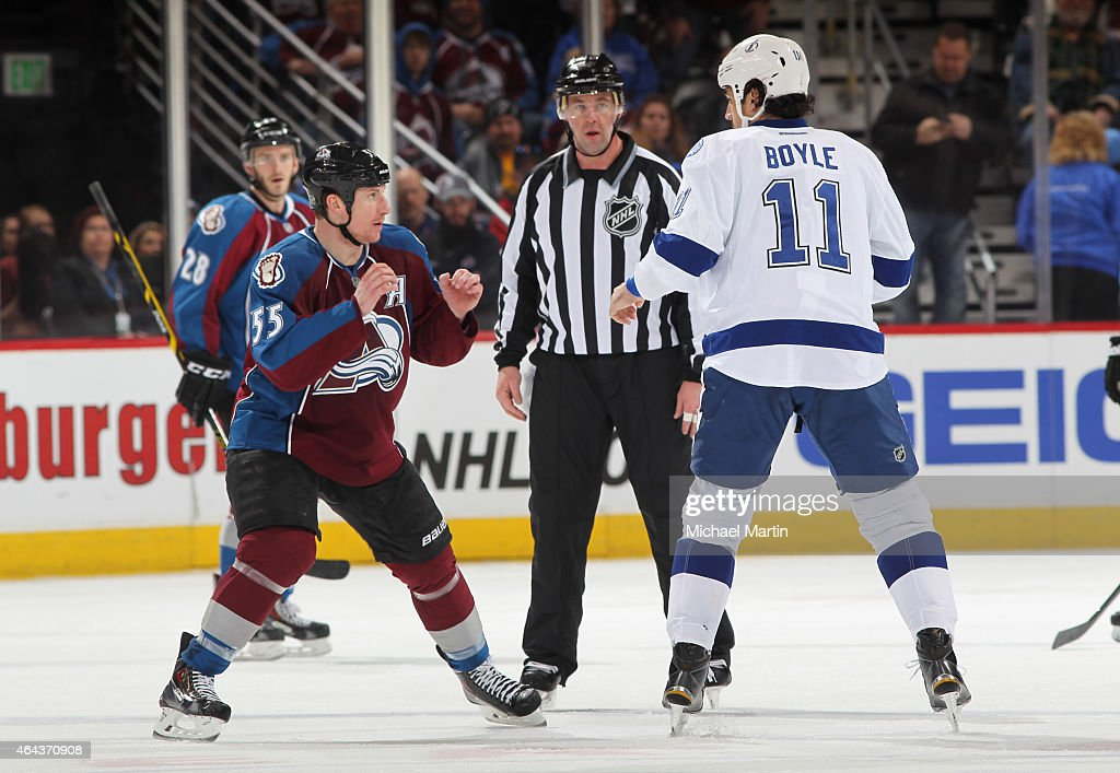 Cody McLeod of the Colorado Avalanche squares off against Brian Boyle of the Tampa Bay Lightning at the Pepsi Center on February 22 2015 in Denver...