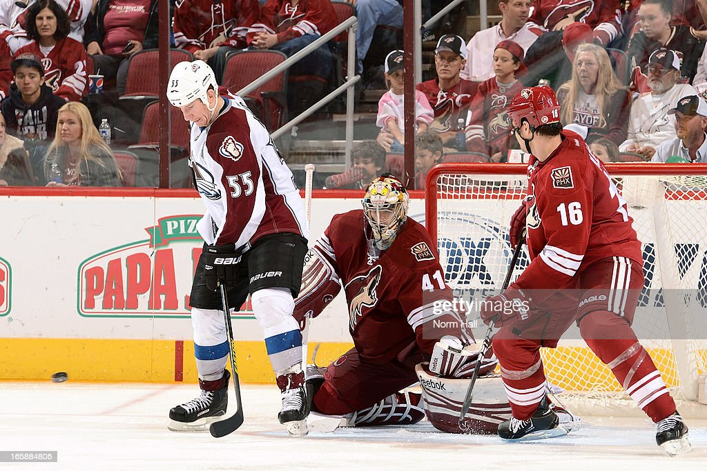 <a gi-track='captionPersonalityLinkClicked' href=/galleries/search?phrase=Cody+McLeod&family=editorial&specificpeople=2242985 ng-click='$event.stopPropagation()'>Cody McLeod</a> #55 of the Colorado Avalanche tries to re-direct the puck in front of goaltender Mike Smith #41 and <a gi-track='captionPersonalityLinkClicked' href=/galleries/search?phrase=Rostislav+Klesla&family=editorial&specificpeople=207079 ng-click='$event.stopPropagation()'>Rostislav Klesla</a> #16 of the Phoenix Coyotes during the third period at Jobing.com Arena on April 6, 2013 in Glendale, Arizona.