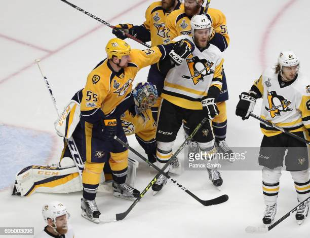 Cody McLeod of the Nashville Predators and Carter Rowney of the Pittsburgh Penguins mix it up during the third period in Game Six of the 2017 NHL...