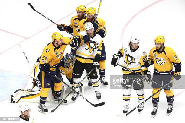 Cody McLeod of the Nashville Predators and Carter Rowney of the Pittsburgh Penguins battle for position during the third period in Game Six of the...