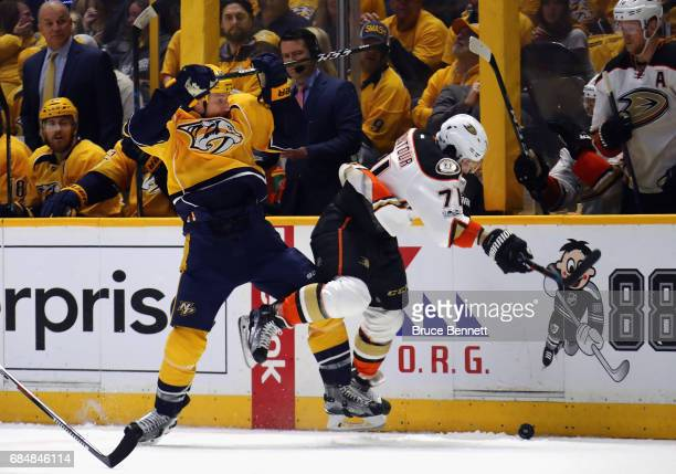 Cody McLeod of the Nashville Predators checks Brandon Montour of the Anaheim Ducks during the first period in Game Four of the Western Conference...