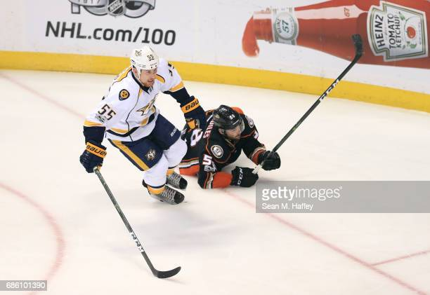 Cody McLeod of the Nashville Predators checks Nic Kerdiles of the Anaheim Ducks in the first period of Game Five of the Western Conference Final...