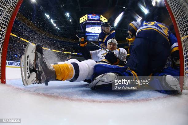 Cody McLeod of the Nashville Predators crashes into the goal against the St Louis Blues in Game One of the Western Conference Second Round during the...