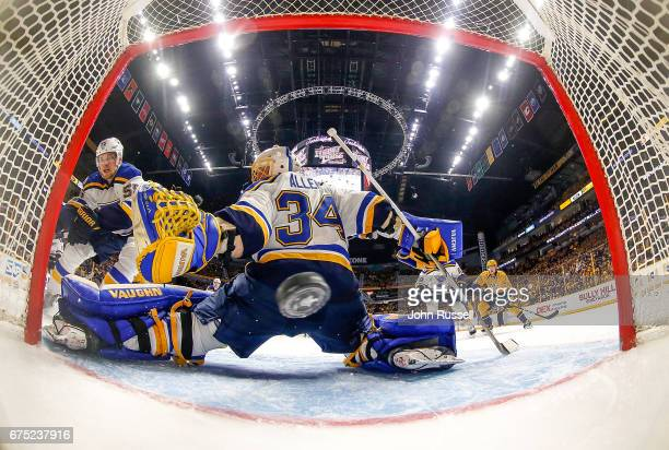 Cody McLeod of the Nashville Predators puts the puck in the net against Jake Allen of the St Louis Blues in the second period of Game Three of the...