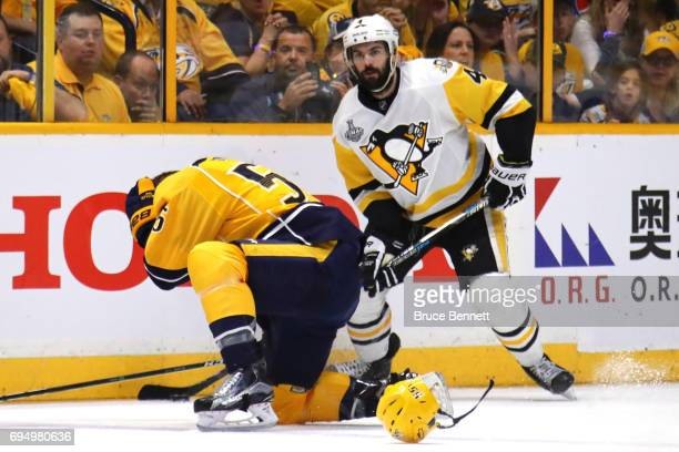 Cody McLeod of the Nashville Predators reacts as he is defended by Justin Schultz of the Pittsburgh Penguins during the first period in Game Six of...